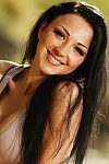Ukrainian girl Alla,30 years old with green eyes and dark brown hair.