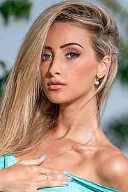 Ukrainian girl Victoria,25 years old with blue eyes and blonde hair.