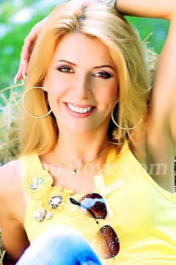 Ukrainian girl Olga,43 years old with brown eyes and blonde hair. Olga