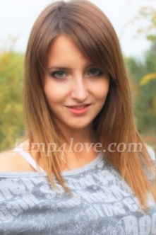 girl , years old with green eyes and light brown hair. Christina