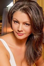 Ukrainian girl Tatyana,40 years old with brown eyes and dark brown hair.