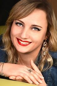 Ukrainian girl Victoriya,37 years old with blue eyes and light brown hair.