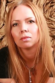 Ukrainian girl Olga,43 years old with grey eyes and blonde hair.