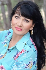 Ukrainian girl Tatiana,50 years old with brown eyes and black hair.