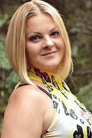 Ukrainian girl Oksana ,35 years old with blue eyes and blonde hair.