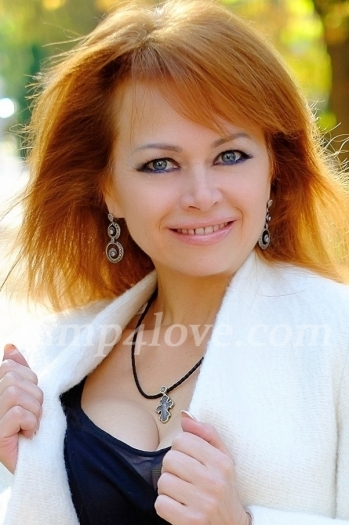 Ukrainian girl Tatyana,56 years old with blue eyes and red hair. Tatyana