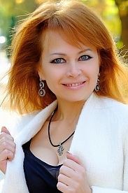 Ukrainian girl Tatyana,56 years old with blue eyes and red hair.