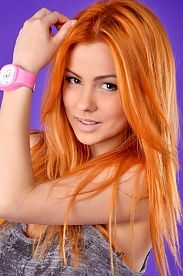 Ukrainian girl Radoslava,23 years old with brown eyes and red hair.