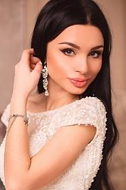 Ukrainian girl Stefaniya,21 years old with grey eyes and black hair.