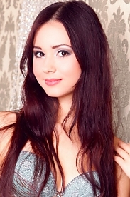 Ukrainian girl Olga,31 years old with brown eyes and black hair.