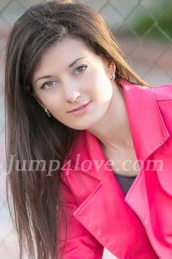 Ukrainian girl Olga,39 years old with green eyes and dark brown hair. Olga