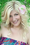 Ukrainian girl Larisa,43 years old with grey eyes and blonde hair.
